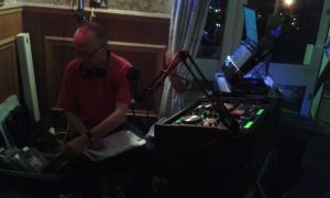 DJ Mart using CD's at Purple Badger, Llanrhidian