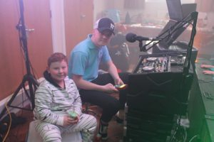 DJ Ethan Grey having some help with a DJ assistant  in Neath