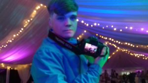 DJ Ethan, in Llanelli, with our camera getting photos for blogs